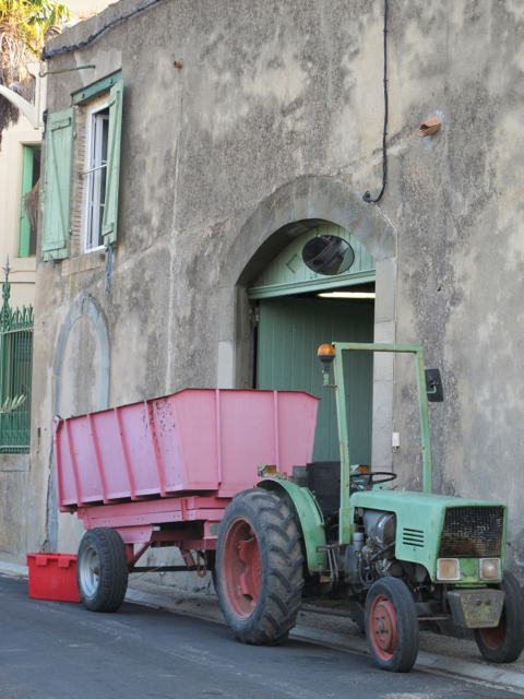 green and red tractor
