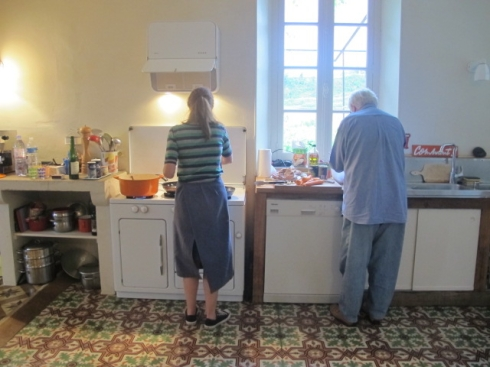 dad and junior at the stove