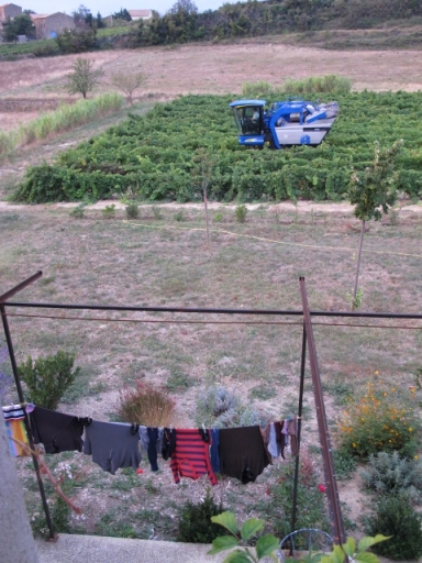 harvester at home with clothes line