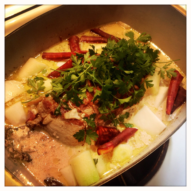 After the meat has been cooking for awhile in the milk, drop the vegies and parsley in