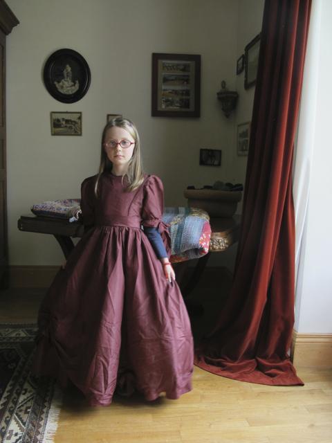 a little girl in an old dress