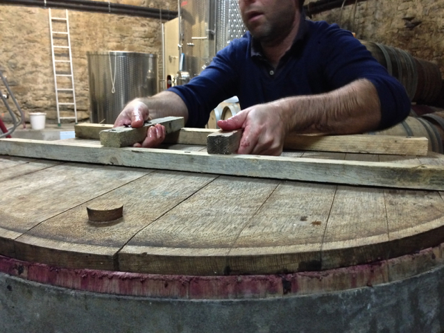 the Grenache resting in wooden 'tank'